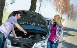 Car breakdown couple calling for road assistance man point engine